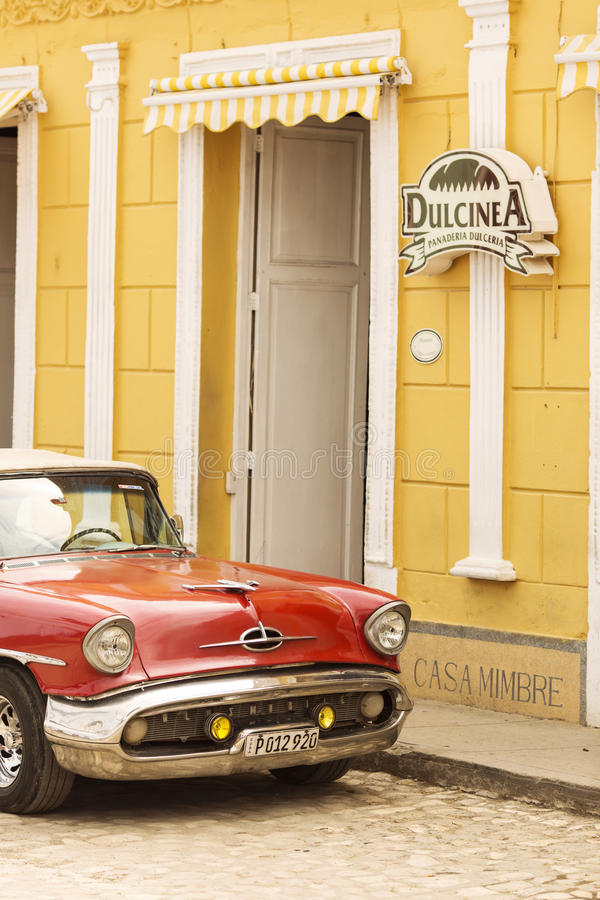 TRINIDAD, CUBA - DECEMBER 8, 2013:Red classic American car and c stock photography