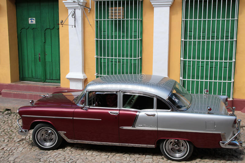 Trinidad house and a Classic old American car royalty free stock image