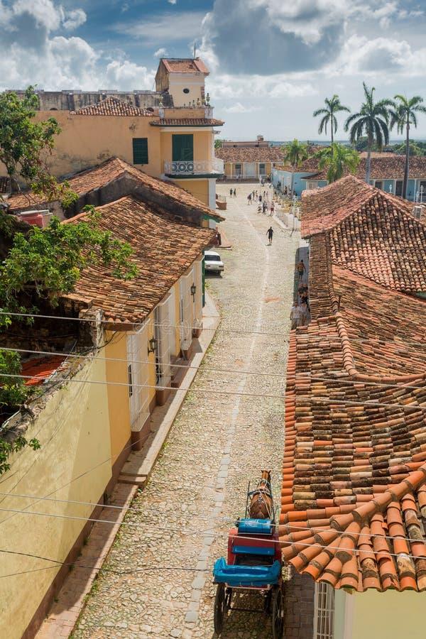 Trinidad Kuba - December 6, 2017: Kyrka av den heliga Treenighet Iglesia de la Santisima Trinidad och Plazaborgmästaren arkivbild