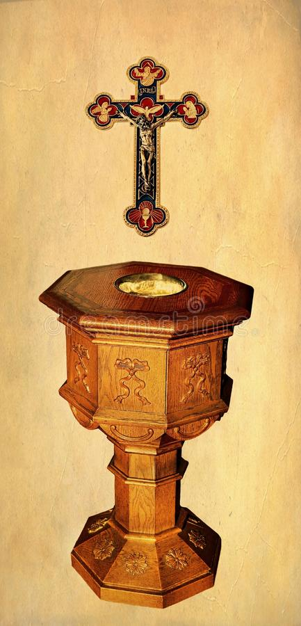 Trinitarian cross with body of Christ with baptism font stock image