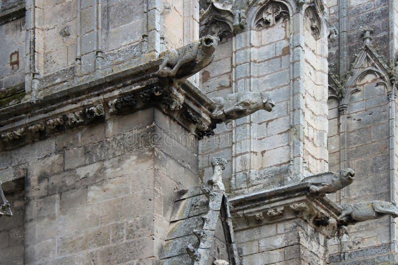 Trinity abbey - Vendôme - France. Gargoyles decorate the facade of the church of the Trinity abbey in Vendôme (France). Des gargouilles décorent la fa stock images