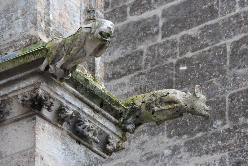 Trinity abbey - Vendôme - France. Gargoyles decorate the facade of the church of the Trinity abbey in Vendôme (France). Des gargouilles décorent la fa royalty free stock photography
