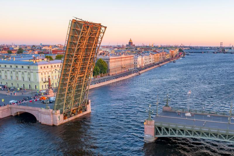 Trinity Bridge with a divorced state. Evening aerial view of the Palace Embankment of St. Isaac`s Cathedral stock image