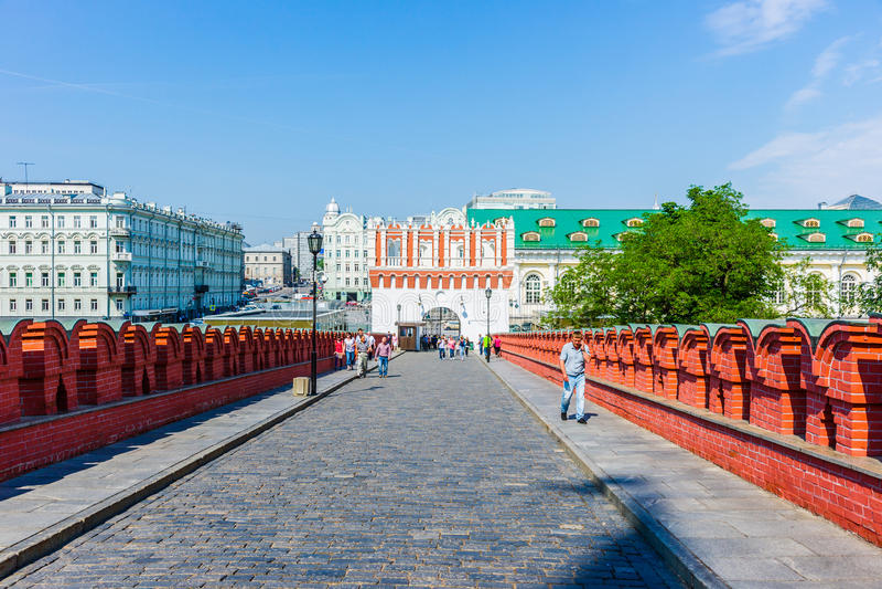 Trinity bridge - tourist entrance to Moscow Kremlin. Kutafia tower (center) and Troitsky (Trinity) bridge - tourist entrance to the Kremlin of Moscow, Russia, on royalty free stock photos