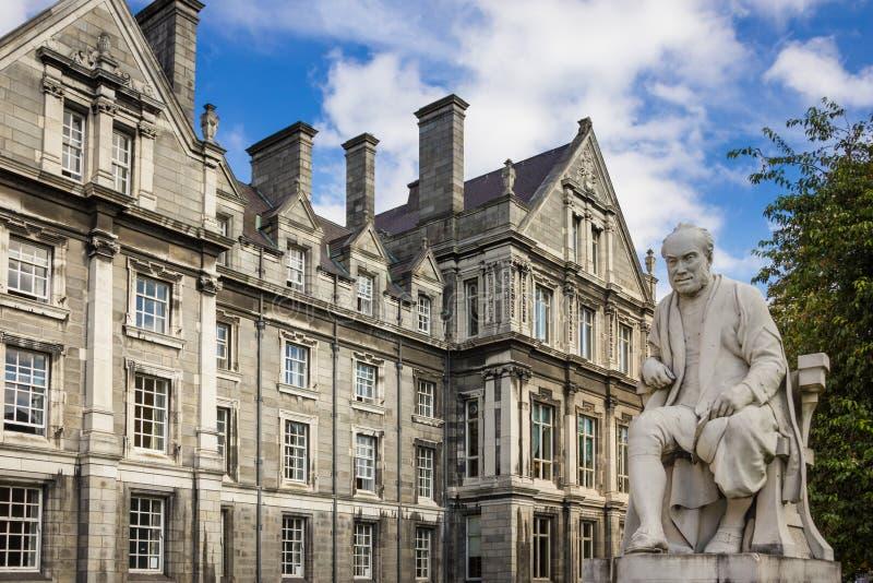 Trinity College. Graduates Memorial Building . Dublin. Ireland. Trinity College. the Graduates Memorial Building and statue of George Salmon. Dublin. Ireland stock image