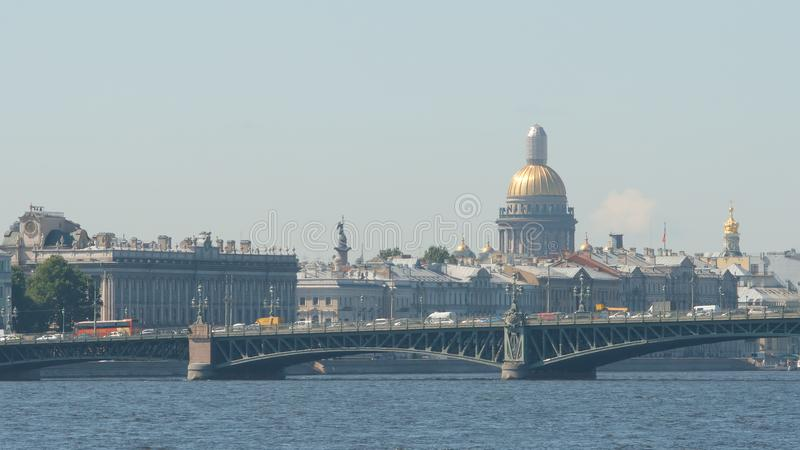 Trinity Troitsky bridge and the Isaac`s Cathedral in the summer - St Petersburg, Russia stock photo