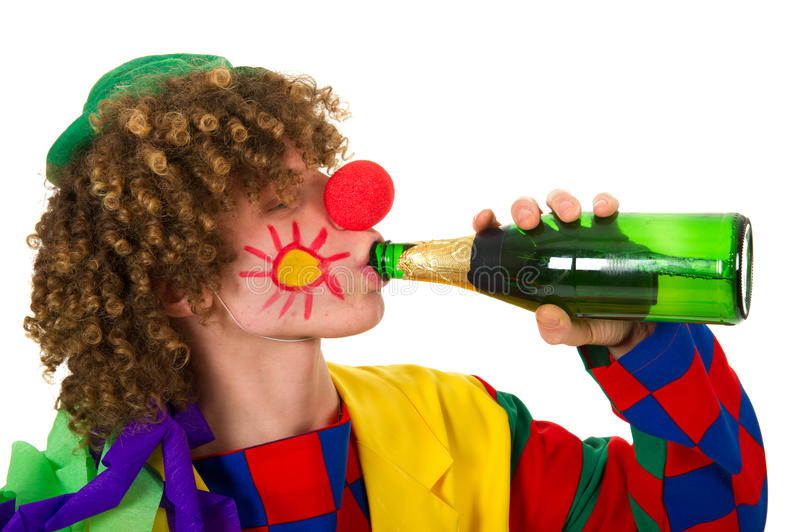 Trinkender Clown stockbild