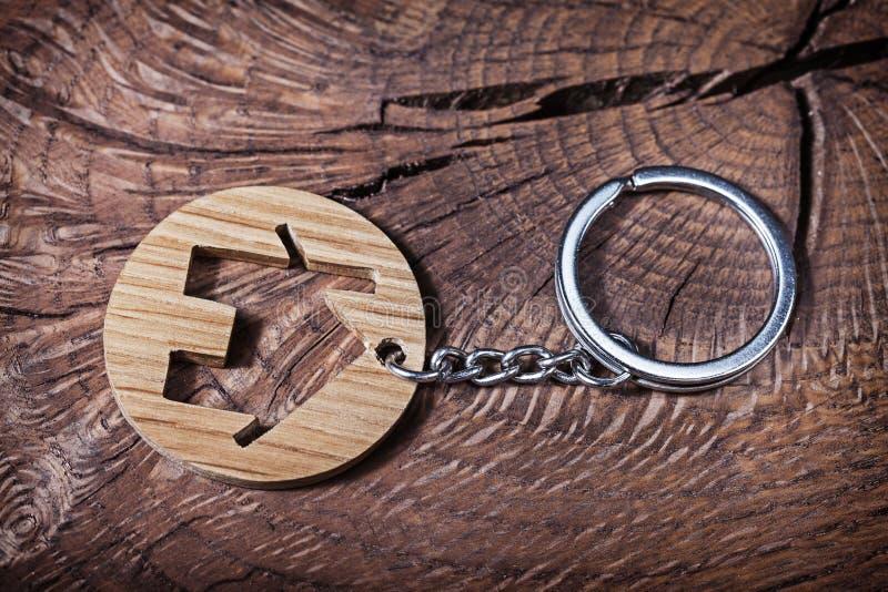 Trinket house without  keys on wood background royalty free stock photography