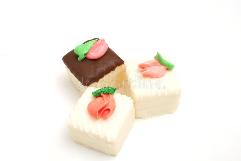 trio of cupcakes on white stock image