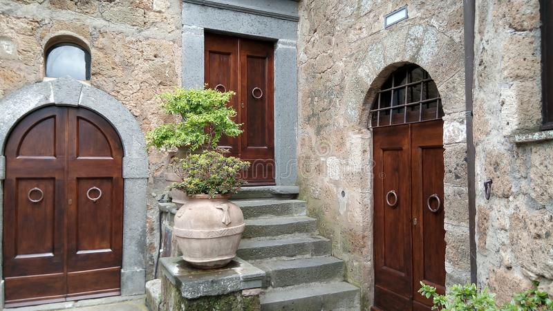A trio of doors in a Tuscan hill town stock photography