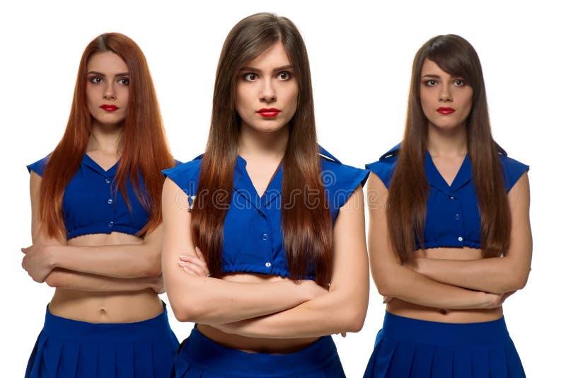 Trio peinzende vrouwen drietallenzusters stock afbeeldingen