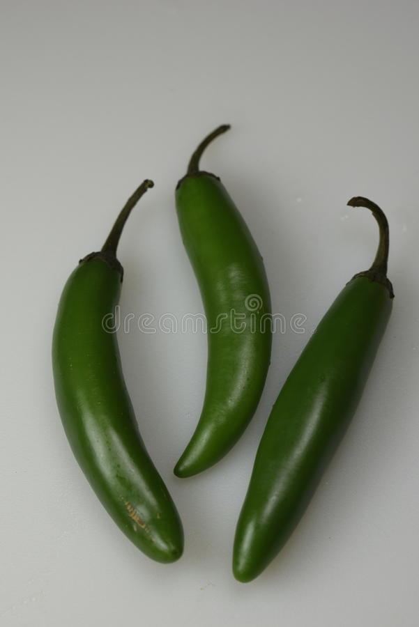 A trio of serrano peppers royalty free stock photography