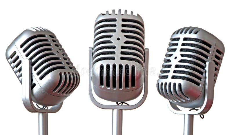 Trio of vintage microphones stock photos