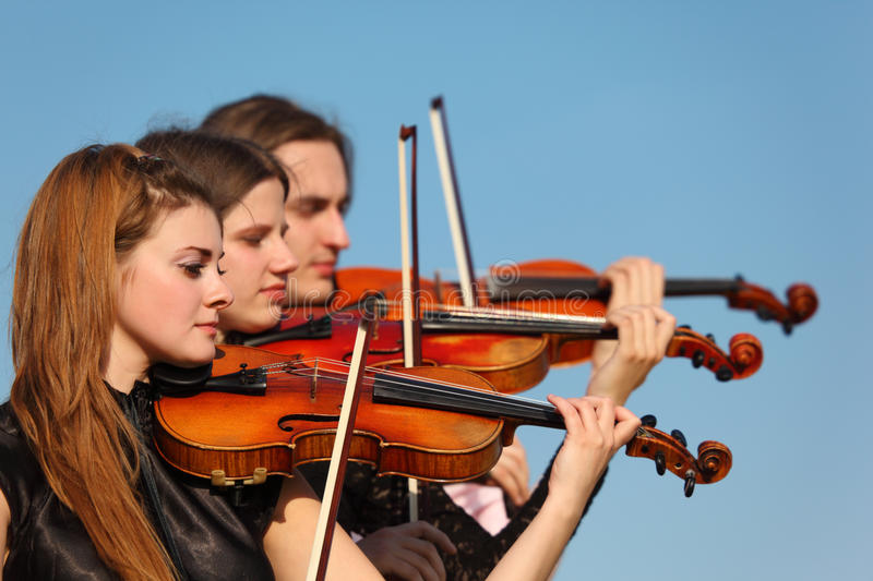 Download Trio Of Violinists Plays Against Sky Stock Image - Image of beautiful, nature: 10504885