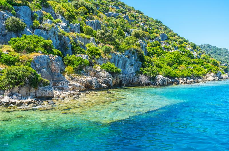 Shores of Kekova Island, Turkey. The trip along the coastline of Kekova Island with a view on ruins of the sunken city, Turkey royalty free stock photo