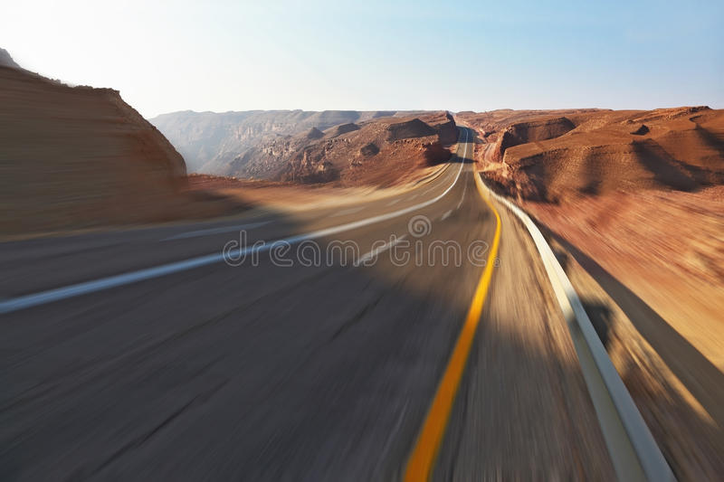 Trip driving on high speed in stone desert stock photography