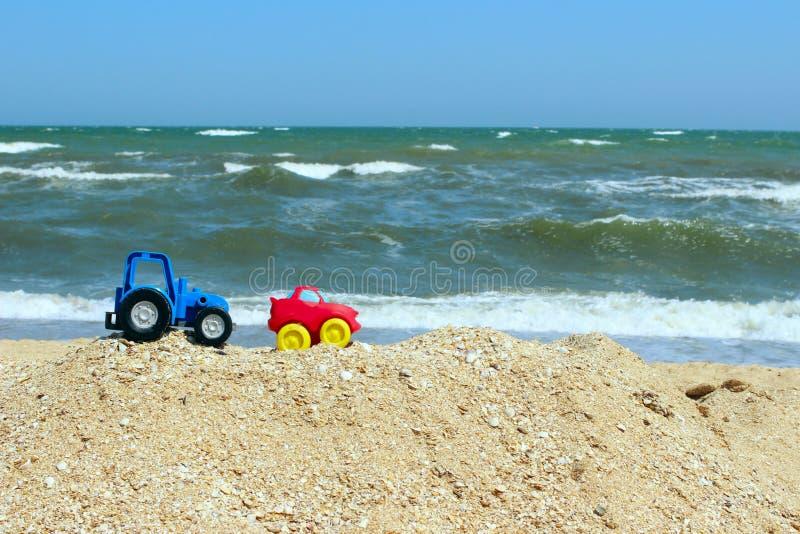 Trip To The Ocean. Little Cars on the Beach.Kids Toys on Tropical Sand Beach. Toy`s Cars. stock photos