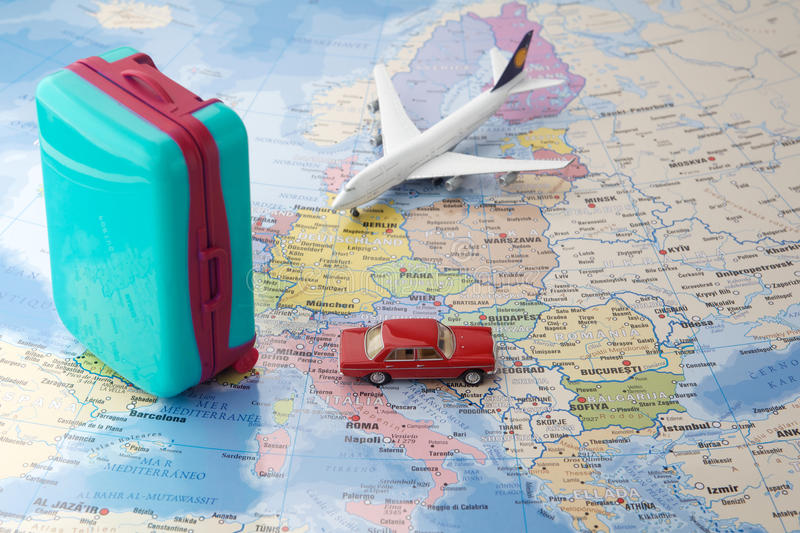 Trip or traveling by airplane concept. Miniature toy airplane and suitcases on map. royalty free stock photos