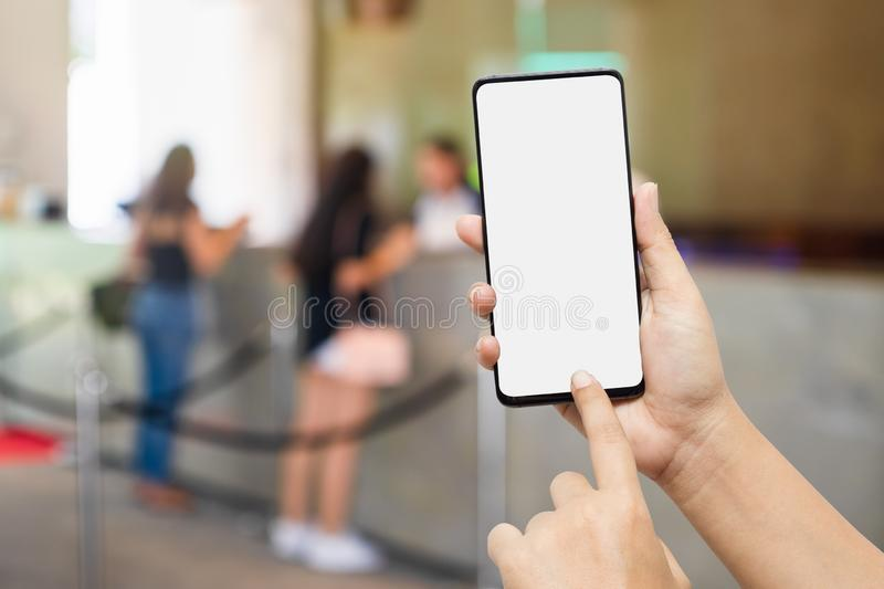 Trip vacation, Hotel reservation, tourism mobile phone mockup. Hand holding blank screen smart phone searching for information of royalty free stock photos