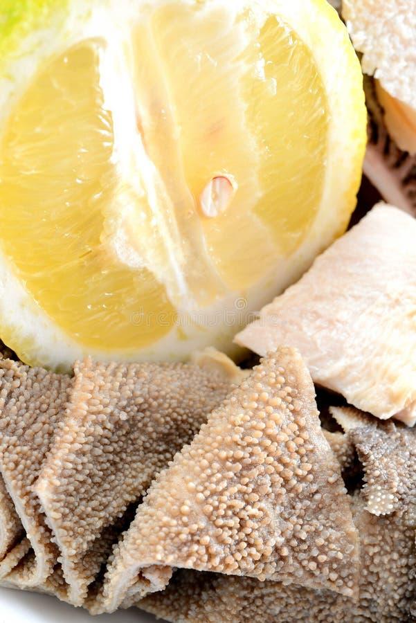 Tripes avec le citron photographie stock