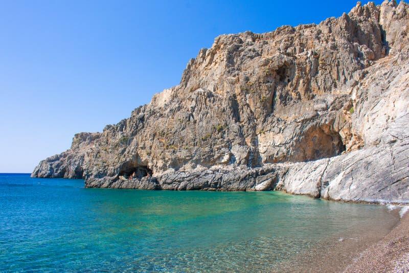 Tripiti beach with colordul sea east Crete. Filakas mountain near to Lendas, Crete Greece. Beautiful landscape. Sea and mountains. Copy space for text stock photo
