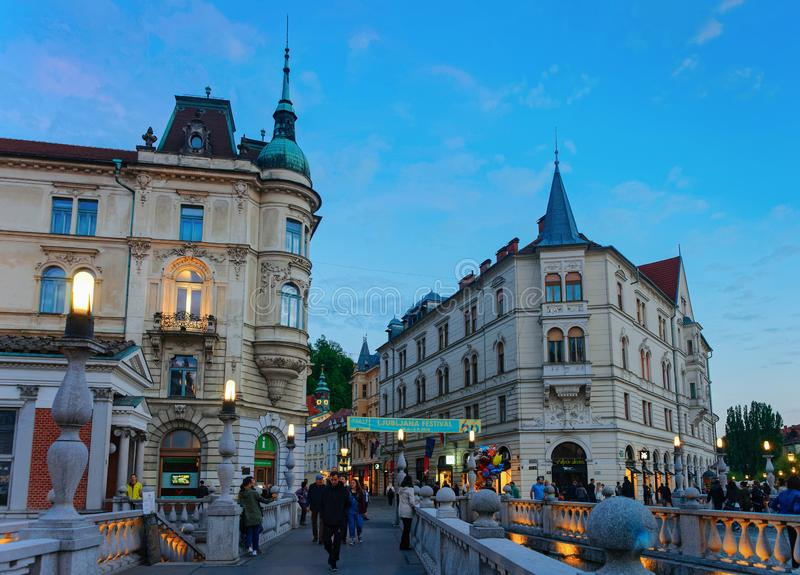 Triple bridge and Ljubljanica River at Ljubljana Slovenia evening royalty free stock photos
