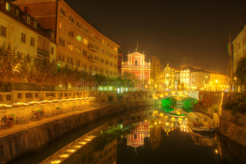 The Triple Bridge over the Ljubljanica River in the city center of Ljubljana and Franciscan church - night picture royalty free stock photos