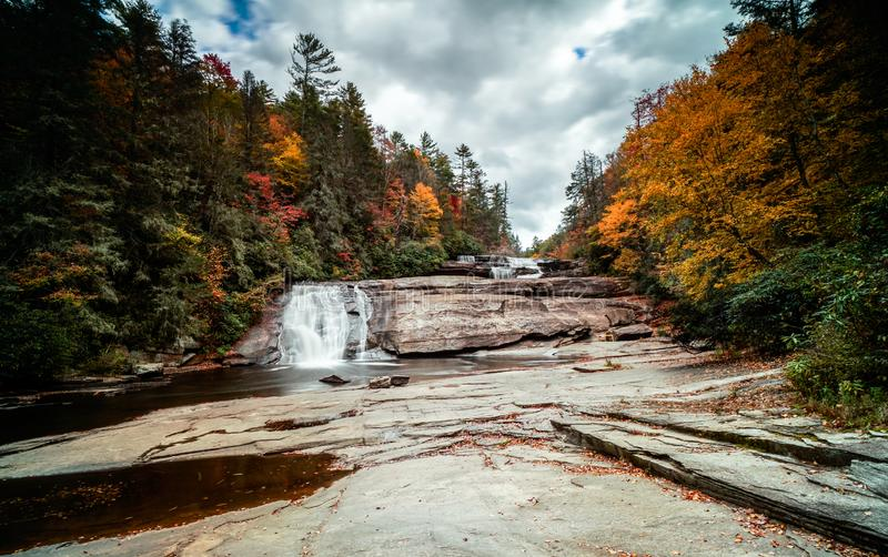 Waterfall in fall color forest in the Appalachian mountains of North Carolina royalty free stock photography