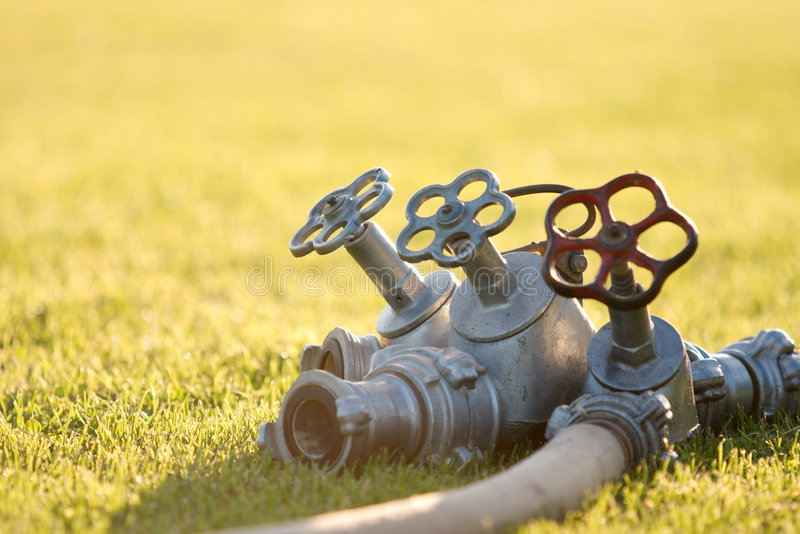 Download Triple faucet on the grass stock image. Image of fitting - 5552803