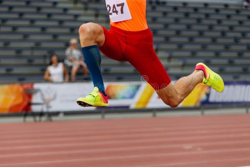 Triple jump legs athlete jumper. Track and field sport stock photos