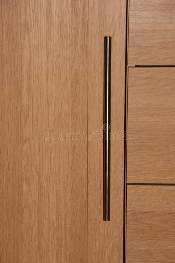 Triple wood effect drawer unit with chrome handles close up 2 stock image