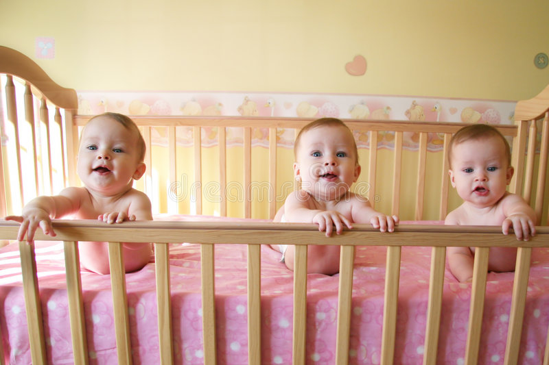 Triplet Baby Girls stock images