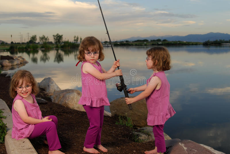 Triplets at the lake stock photos