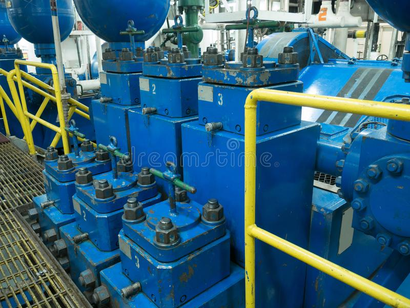 Triplex mud pumps for oil drilling rig in the pump room. They are ready to work royalty free stock images
