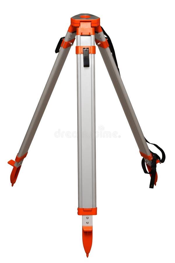 Tripod. Aluminium geodetic tripod isolated on a white background royalty free stock images