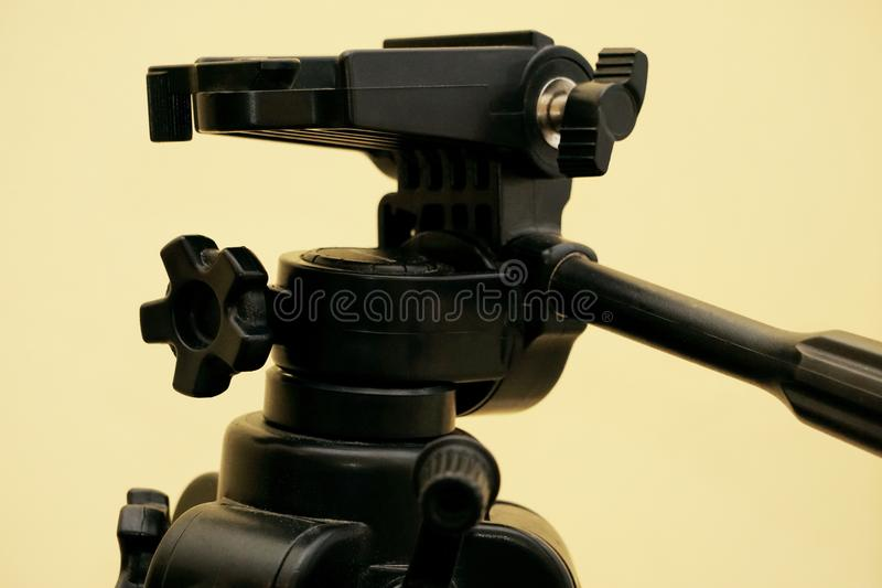 Tripod for the ball head close-up. on a yellow background stock photos