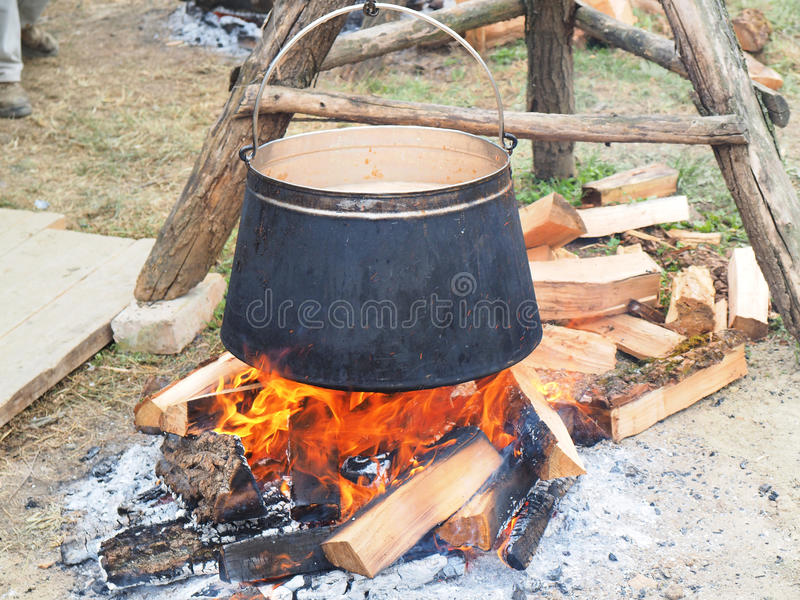 Tripod with kettle ready for cooking. Fish paprikasdish caracteristic for Slavonija and Baranja stock image