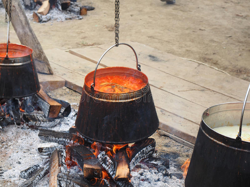 Tripod with kettle ready for cooking. Fish paprikasdish caracteristic for Slavonija and Baranja stock images