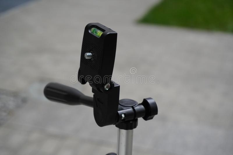 Tripod for phone or camera. the equipment of the photographer, used to shooting video or photos, of yourself or other people, royalty free stock photography