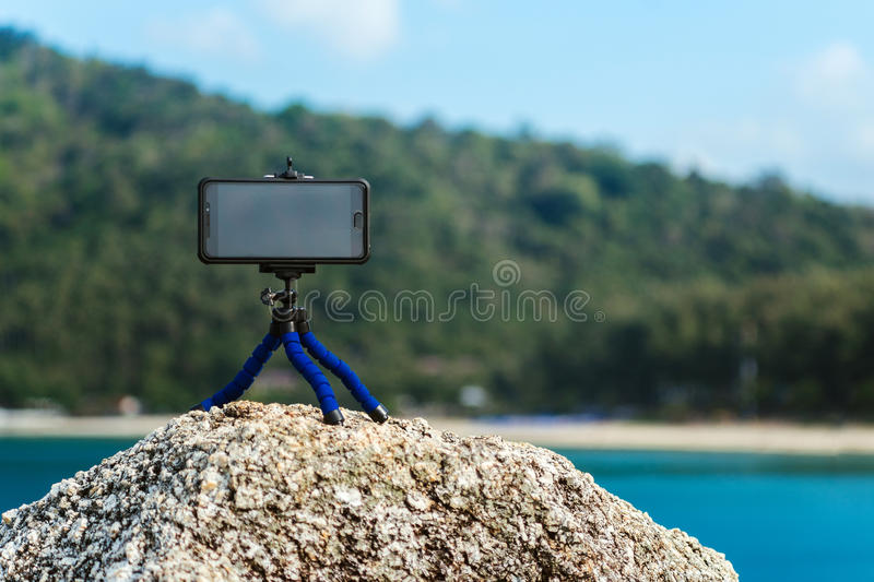 Tripod for phone. The phone shoots video on a tripod royalty free stock photo