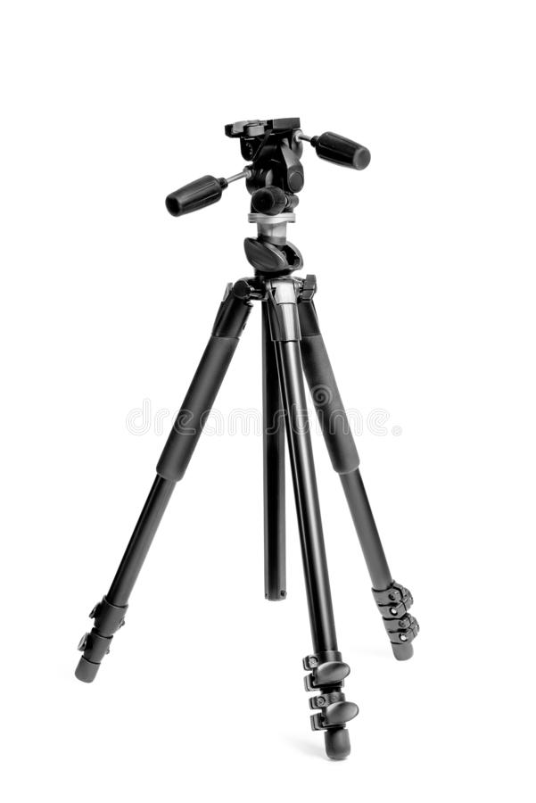 Tripod for photo camera in photo studio on white background. Close-up stock photo