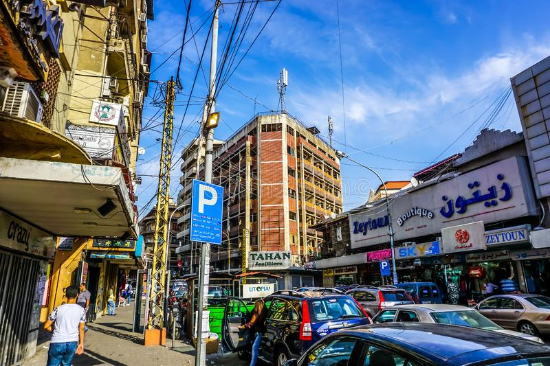 Tripoli Common Shopping Street. View with Traffic and Multi Level Apartment Buildings stock images