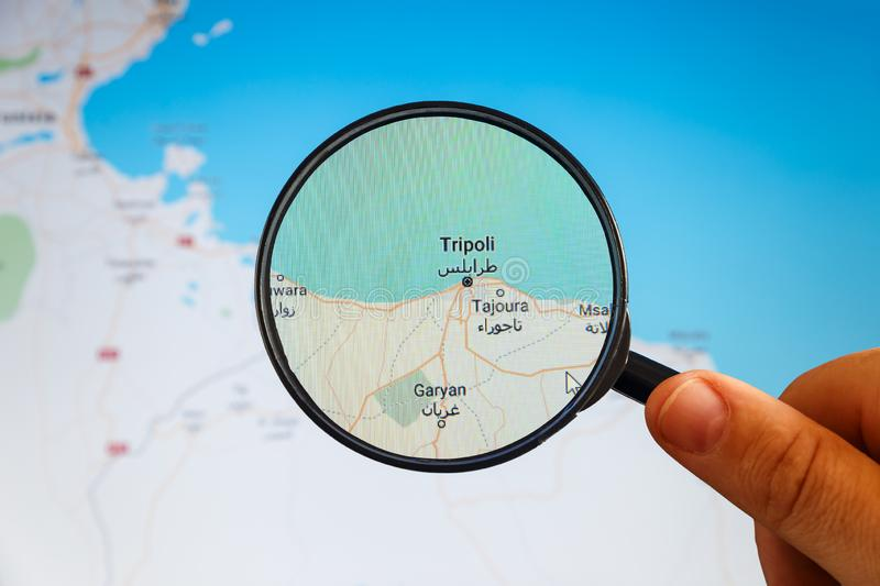 Tripoli, Libya. Political map. City visualization illustrative concept on display screen through magnifying glass in the hand stock images