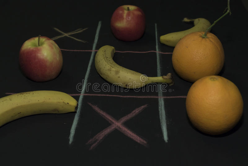 Tris Game with fruit royalty free stock images