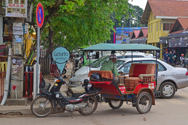 Trishaw parked nearby around Psar Chaa Siem Reap old market in the middle of the Cambodia city. This image is taken nearby the popular pub street with the old stock image