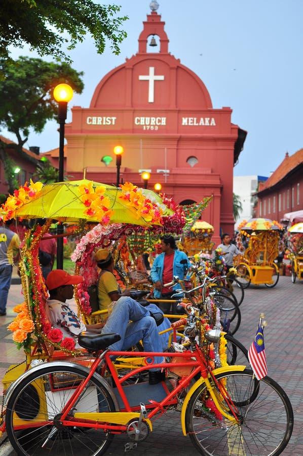 Trishaw peddler in Melaka stock photography