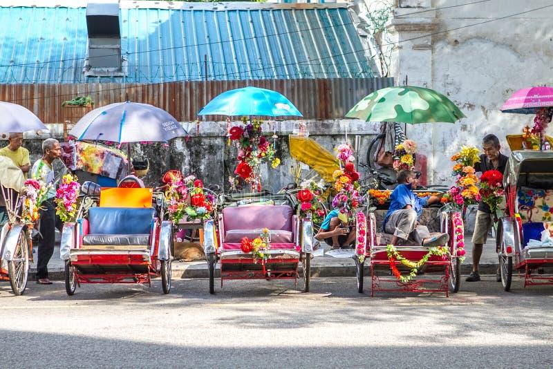 Trishaws在乔治城槟榔岛 免版税库存照片