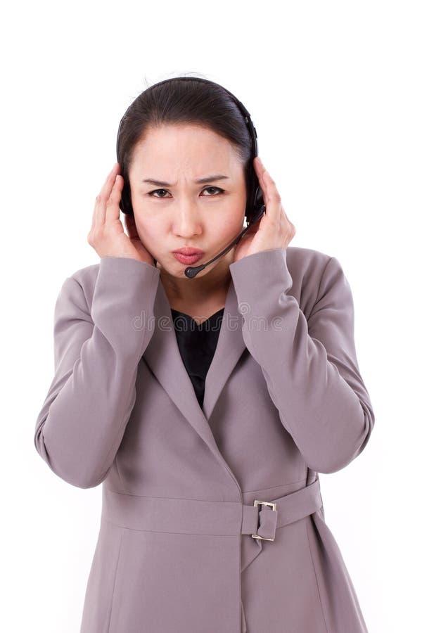 Triste, personal de servicio de cliente descontento con las auriculares imágenes de archivo libres de regalías
