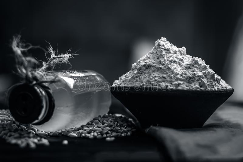 Triticum,wheat flourwith seeds and a bottle of common cooking oil. royalty free stock images
