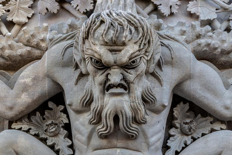 Triton sobre o arco de lanceta fotografia de stock royalty free